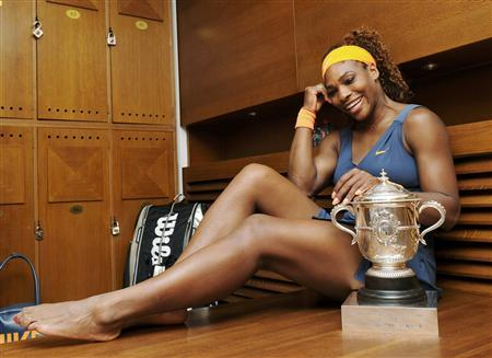 Serena Williams of the U.S. poses with her trophy after defeating Maria Sharapova of Russia in their women's singles final match to win the French Open tennis tournament at the Roland Garros stadium in Paris June 8, 2013. REUTERS/Corinne Dubreuil/Pool