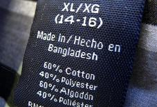 The clothing tag on a boy's shirt which is made in Bangladesh is shown after purchase from a Walmart store in Encinitas, California, May 14, 2013. REUTERS/Mike Blake