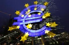 An illuminated euro sign is seen in front of the headquarters of the European Central Bank (ECB) in the late evening in Frankfurt January 8, 2013. REUTERS/Kai Pfaffenbach