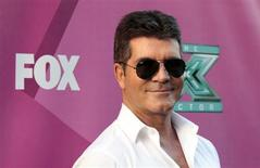 """Judge Simon Cowell poses at the season two premiere of the television series """"The X Factor"""" at Grauman's Chinese theatre in Hollywood, California September 11, 2012. REUTERS/Mario Anzuoni"""