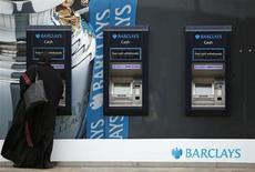 A woman uses a cash point at a Barclays Bank in Leicester, central England April 24, 2013. REUTERS/Darren Staples
