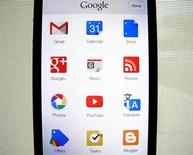 Google apps are shown on an Apple iphone 5 in this photo illustration in Encinitas, California, April 16, 2013. REUTERS/Mike Blake