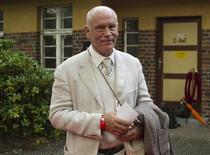 U.S. actor John Malkovich arrives for the premiere of the opera Carmen, directed by Volker Schloendorff, at the Seefestpiele (Lake Festival) at Lake Wannsee in Berlin August 16, 2012. REUTERS/Thomas Peter