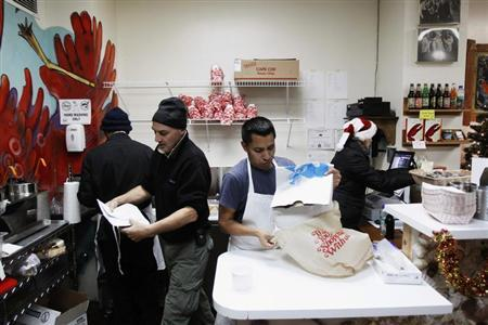 Small-business owners Ralph Gorham (2nd L) and Susan Povich (R) work with their employees to sell lobster rolls at their shop ''Redhook Lobster Pound'' in New York December 16, 2010. REUTERS/Lucas Jackson