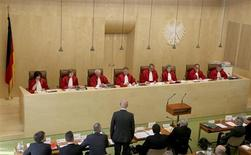 Christian Democratic Union's member Siegfried Kauder stands in front of the President of the German Constitutional Court (Bundesverfassungsgericht) Andreas Vosskuhle (5th L) and other judges of the second senate during a hearing at the court in Karlsruhe, June 11, 2013. REUTERS/Ralf Stockhoff