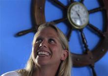 Chloe McCardel, an Australian swimmer, smiles during a news conference in Havana June 11, 2013. REUTERS/Enrique De La Osa