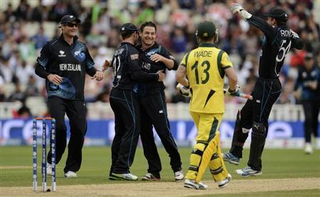 New Zealand's Nathan McCullum (3rd L) is congratulated after dismissing Australia's Matthew Wade (2nd R) during the ICC Champions Trophy group A match at Edgbaston cricket ground, Birmingham. REUTERS/Philip Brown