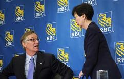Royal Bank of Canada (RBC) President and CEO Gordon Nixon speaks to Chief Financial Officer Janice Fukakusa (R) after a news conference following the bank's Annual General Meeting in Calgary, Alberta February 28, 2013. REUTERS/Mike Sturk