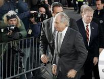 Accused swindler Bernard Madoff (front) enters the Manhattan federal court house in New York March 12, 2009. REUTERS/Shannon Stapleton