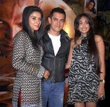 Bollywood actors Asin, Aamir Khan and Jiah Khan (L-R) pose at a party for their movie Ghajini in Mumbai December 30, 2008. REUTERS/Manav Manglani