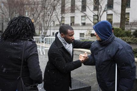 David Floyd (L), the lead plaintiff in the class-action lawsuit Floyd v. City of New York, regarding the New York Police Department's ''stop and frisk'' crime-fighting tactic, greets a well-wisher after departing Manhattan Federal Court in New York, March 18, 2013. REUTERS/Lucas Jackson