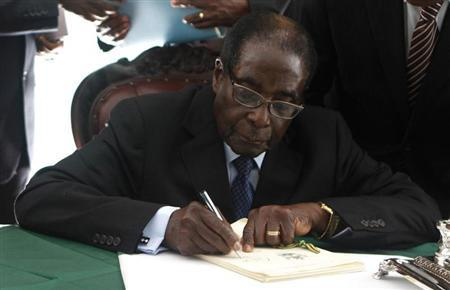 Zimbabwe President Robert Mugabe signs Zimbabwe's new constitution into law in the capital Harare, replacing a 33-year-old document forged in the dying days of British colonial rule and paving the way for elections later this year, May 22, 2013. REUTERS/Philimon Bulawayo