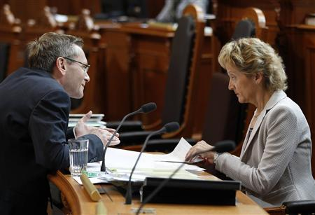 Swiss Finance Minister Eveline Widmer-Schlumpf (R) talks to Councillor of State Primin Bischof during a debate on the tax agreement between Switzerland and the U.S. in Bern June 12, 2013. REUTERS/Ruben Sprich