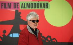"""Spanish director Pedro Almodovar poses at the photocall of his latest film """"Los amantes pasajeros"""" (I'm so excited) in Madrid March 6, 2013. REUTERS/Juan Medina"""