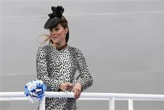 Britain's Catherine, Duchess of Cambridge, cuts a ribbon to release a bottle of champagne during the naming ceremony of the 'Royal Princess' cruise ship in Southampton, southern England June 13, 2013. REUTERS/Stefan Wermuth