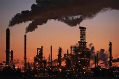 Petro-Canada's Edmonton Refinery and Distribution Centre glows at dusk in Edmonton February 15, 2009. REUTERS/Dan Riedlhuber