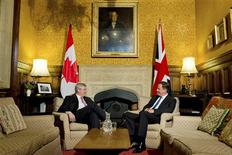 Britain's Prime Minister David Cameron (R) speaks with Canada's Prime Minister Stephen Harper following Harper's address to the House of Commons in central London June 13, 2013. Harper is visiting London ahead of the G8 Summit in Northern Ireland on June 17-18. REUTERS/Leon Neal/POOL