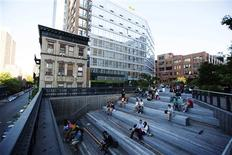 Pedestrians sit in a viewing area on the High Line park in New York, June 12, 2013. REUTERS/Lucas Jackson