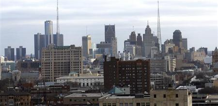 Downtown Detroit is seen through a window from the State Of Michigan offices in Detroit, Michigan February 21, 2013. REUTERS/ Rebecca Cook/Files