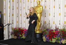 """Adele Adkins of Britain leaves the stage with her Oscar for Best Original Song for """"Skyfall"""" at the 85th Academy Awards in Hollywood, California February 24, 2013. REUTERS/Mike Blake"""