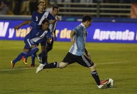 Lionel Messi of Argentina kicks the ball for a goal during a friendly soccer match against Guatemala in the Mateo Flores stadium in Guatemala City, June 14, 2013. REUTERS/Jorge Dan Lopez