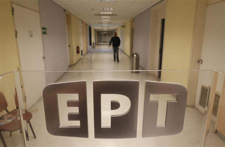 An employee walks in a hall inside Greek state television ERT headquarters in Athens June 13, 2013. REUTERS/John Kolesidis