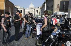 Harley-Davidson bikers gather outside Saint Peter's Square before the start of a mass led by Pope Francis in Rome June 16, 2013. REUTERS/Max Rossi