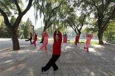 People practise tai chi, a Chinese martial art, during morning exercises at Longtan Park in Beijing in this September 13, 2010 file photo. REUTERS/Grace Liang/Files