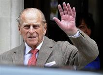 Britain's Prince Philip waves to members of the media as he leaves the King Edward VII Hospital in London June 9, 2012. REUTERS/Paul Hackett