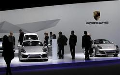Shareholders watch Porsche cars during the annual shareholders meeting of Porsche in Leipzig, April 30, 2013. REUTERS/Fabrizio Bensch