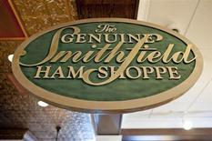 A sign advertising Smithfield hams hangs at the Taste of Smithfield restaurant and gourmet market in Smithfield, Virginia May 30, 2013. REUTERS/Rich-Joseph Facun