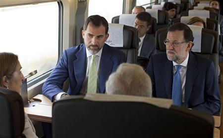 Spain's Crown Prince Felipe (2nd L) rides next to Spain's Prime Minister Mariano Rajoy (R) and Minister of Transport and Development Ana Maria Pastor (L) during the inaugural trip of Spain's newest AVE high speed train service from Madrid to Alicante, eastern Spain, June 17, 2013. REUTERS/J.J. Guillen/Pool