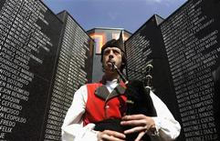 A bagpiper plays the Second Spanish Republic anthem during a ceremony to mark the 79th anniversary of Spain's Second Republic at a cemetery in Gijon April 14, 2010. REUTERS/Eloy Alonso/Files
