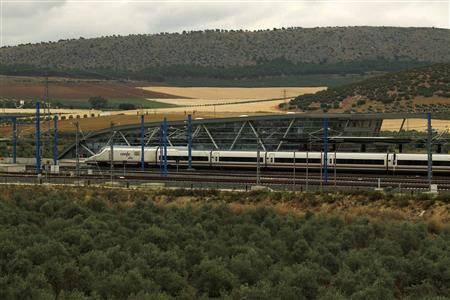 An AVE high-speed train leaves the Antequera-Santa Ana train station, near Antequera, southern Spain June 17, 2013. REUTERS/Jon Nazca (
