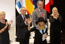 Singer Barbra Streisand (front) waves after receiving a honorary Doctor of Philosophy degree from the Hebrew University in Jerusalem June 17, 2013. REUTERS/Ronen Zvulun