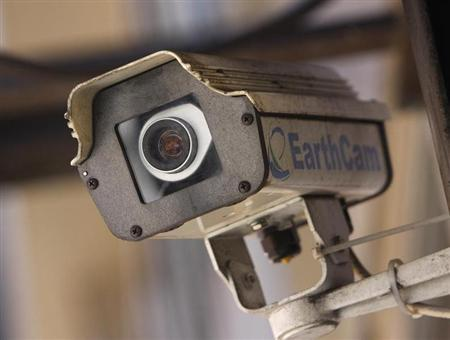A security camera sits on a building in New York City March 6, 2008. REUTERS/Joshua Lott