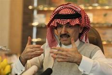 Saudi Prince Alwaleed bin Talal speaks during an interview with Reuters at his offices in Kingdom Tower in Riyadh, May 6, 2013. REUTERS/Faisal Al Nasser