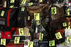 Prices are seen on goods in a shop window in New York City, November 14, 2011. REUTERS/Mike Segar