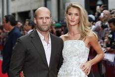 "Actor Jason Statham arrives with his girlfriend Rosie Huntington-Whiteley for the world premiere of ""Hummingbird"", at Leicester Square in central London June 17, 2013. REUTERS/Stefan Wermuth"