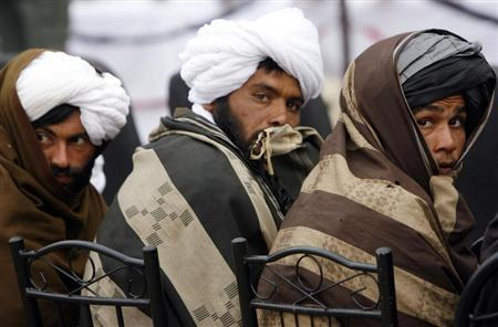 Afghan Taliban look on after handing over their weapons as they join the Afghan government's reconciliation and reintegration program in Herat province, February 17, 2013. REUTERS/Mohmmad Shoib