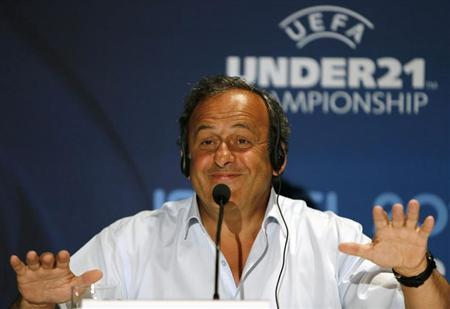 UEFA President Michel Platini gestures during a news conference in Jerusalem, ahead of the UEFA European Under-21 Championship final soccer match June 18, 2013. REUTERS/Ammar Awad