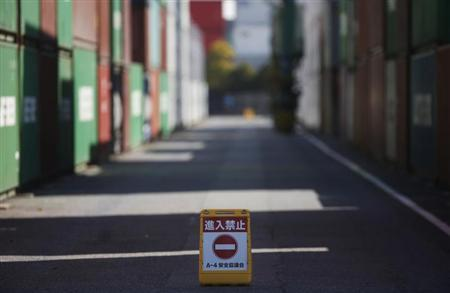 A ''no entry'' sign is seen near containers at a port in Tokyo February 20, 2013. REUTERS/Yuya Shino