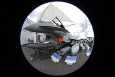 An Eurofighter Typhoon jet is seen with weapons in a static display area, two days before the opening of the 50th Paris Air Show, at the Le Bourget airport near Paris, June 15, 2013. REUTERS/Pascal Rossignol