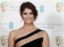 British actress Gemma Arterton poses for photographers at the British Academy of Film and Arts (BAFTA) awards ceremony at the Royal Opera House in London in this February 10, 2013 file photo. REUTERS/Suzanne Plunkett/Files