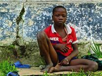 A homeless child begs along a street in the Democratic Republic of Congo (DRC) in capital Kinshasa June 16, 2013. REUTERS/Jonny Hogg