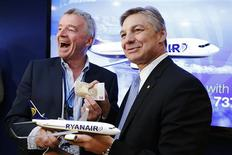 President and CEO of Boeing Commercial Airplanes Ray Conner (R) and Ryanair Chief Executive Michael O'Leary share a light hearted moment as they pose during a signing ceremony at the 50th Paris Air Show, at the Le Bourget airport near Paris, June 19, 2013. REUTERS/Pascal Rossignol