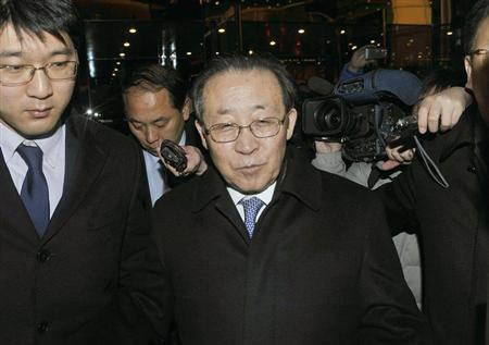 North Korea's First Vice Foreign Minister and envoy to the six-party talks Kim Kye-gwan (2nd L) enters a hotel after a meeting with U.S. Special Representative for North Korea Glyn Davies in Beijing in this photo taken by Kyodo on February 23, 2012. REUTERS/Kyodo