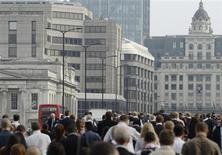 Commuters walk to work across London Bridge, heading into the City of London June 19, 2013. REUTERS/Luke MacGregor