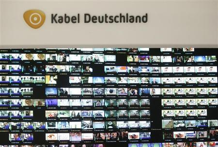 The logo of Germany's biggest cable operator, Kabel Deutschland, is pictured above a monitor wall at the Kabel Deutschland playout center in Frankfurt February 25, 2013. REUTERS/Lisi Niesner