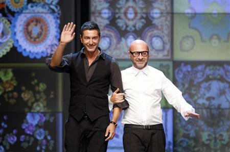 Italian designers Domenico Dolce (R) and Stefano Gabbana acknowledge the applause at the end of D&G Spring/Summer 2012 women's collection show during Milan Fashion Week September 22, 2011. REUTERS/Stefano Rellandini